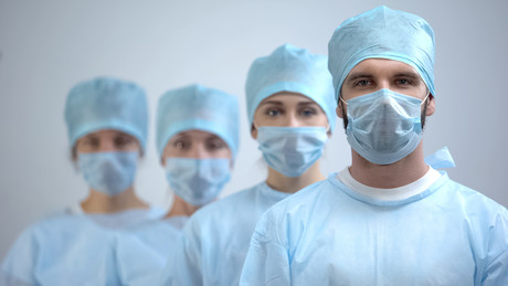 Expert urges caution on healthcare worker cloth mask use