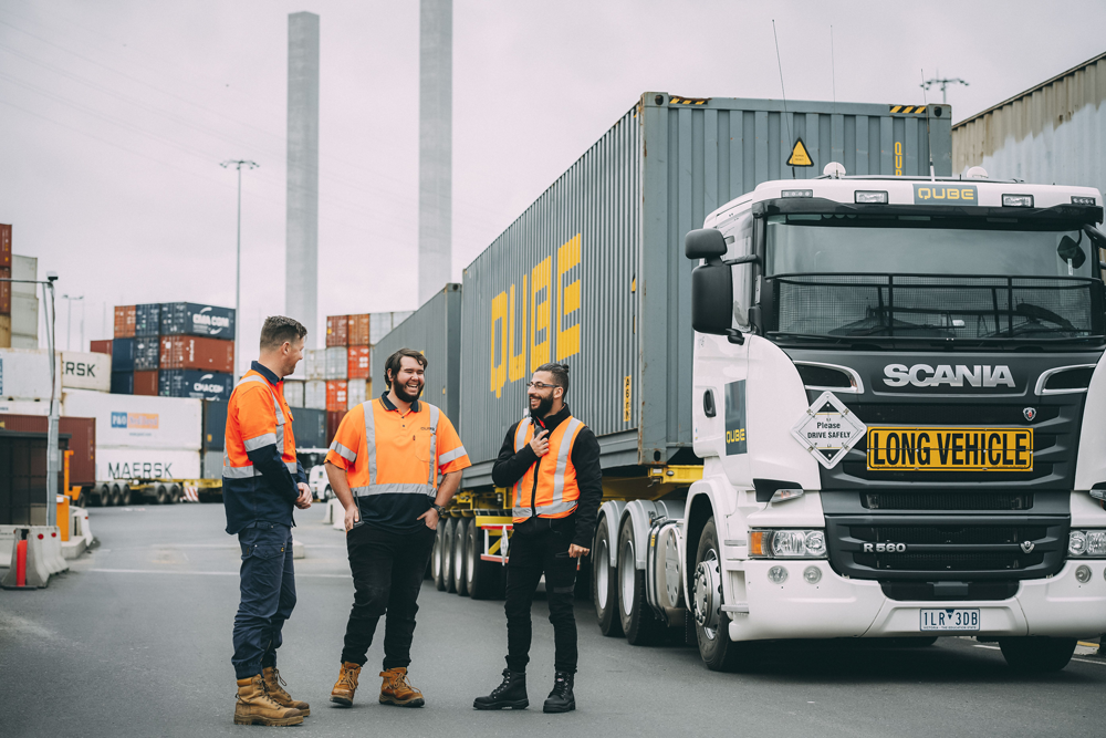 Qube workers and truck